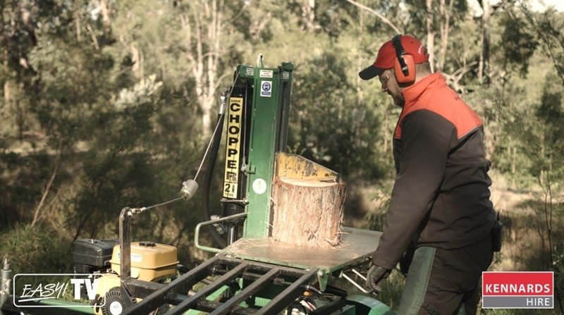 The log splitter will make the square trunk pieces more manageable.