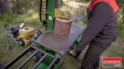 Line the wood up in the centre of the cutting blade, and push down on the handles until the axe is all the way through.