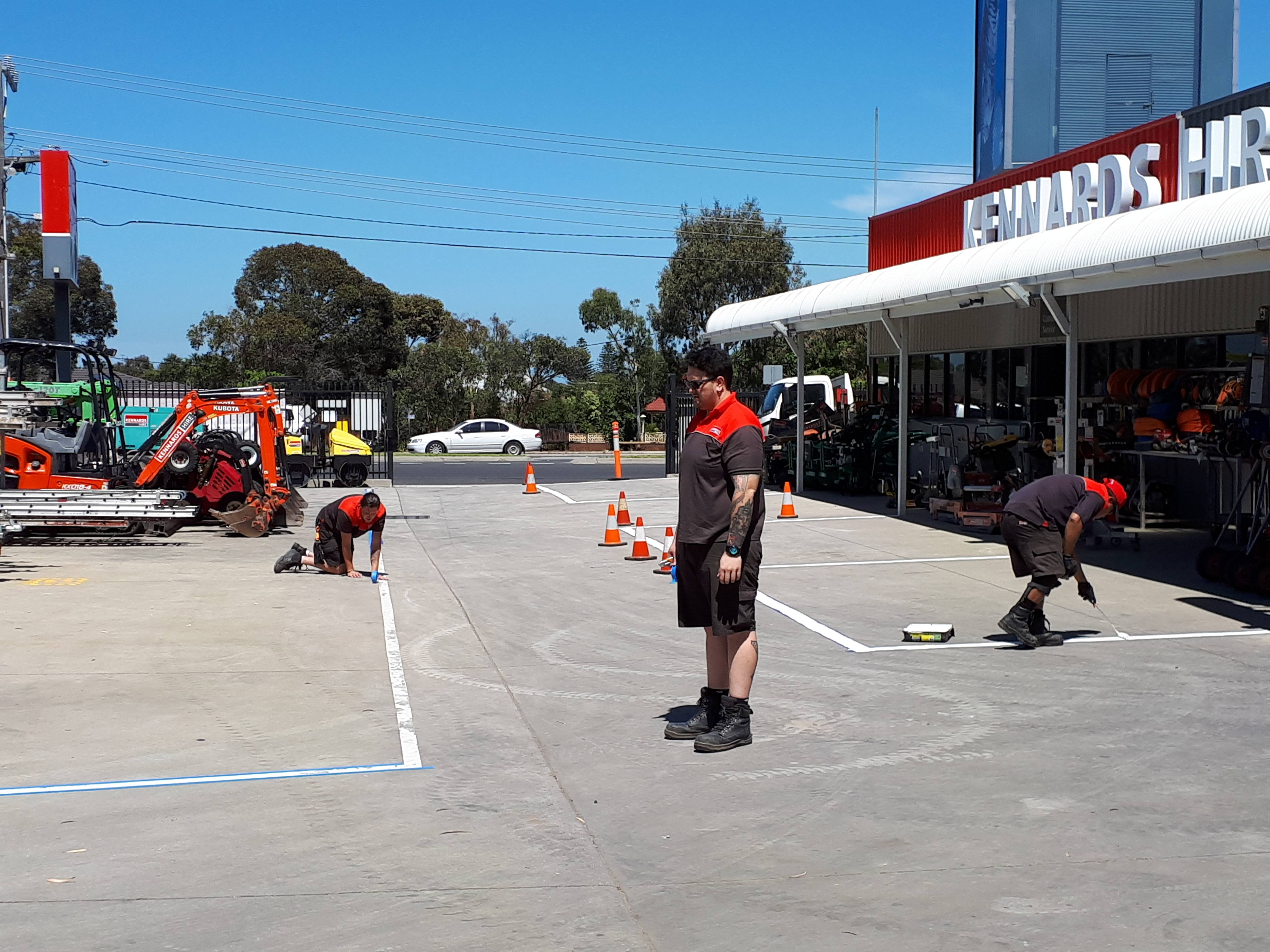 Moorabbin team keeping the yard in mint condition by repainting the lines on the pavement