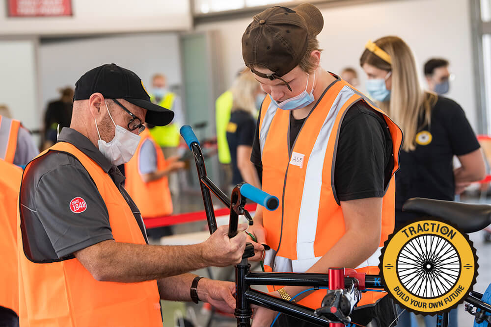 Kennards Hire, GM Queensland, Matt Hardy, assisting youth to build a bike